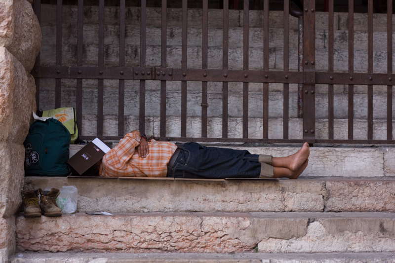Man sleeping in front of Arena of Verona, Italy