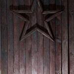 Star on wooden door by Crazy Ivory