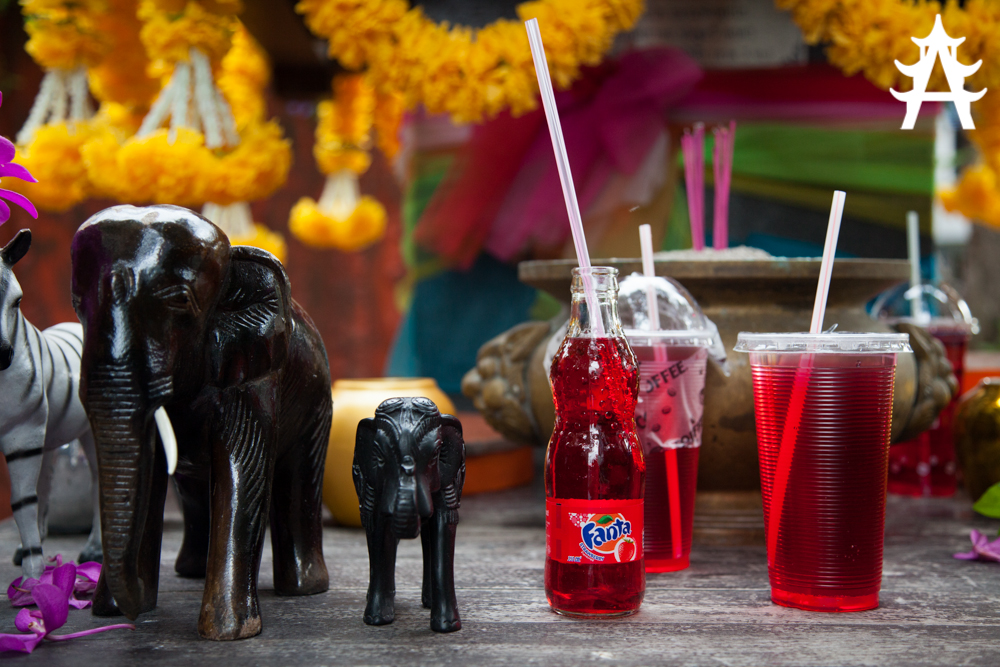 Red Fanta in front of a holy shrine in Bangkok